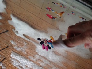 Rub on sticker or adhesive