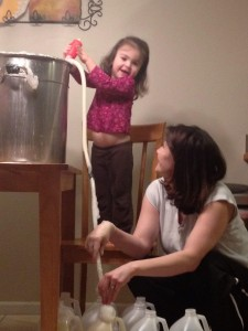 My daughter Molly helping me fill bottles of laundry soap.